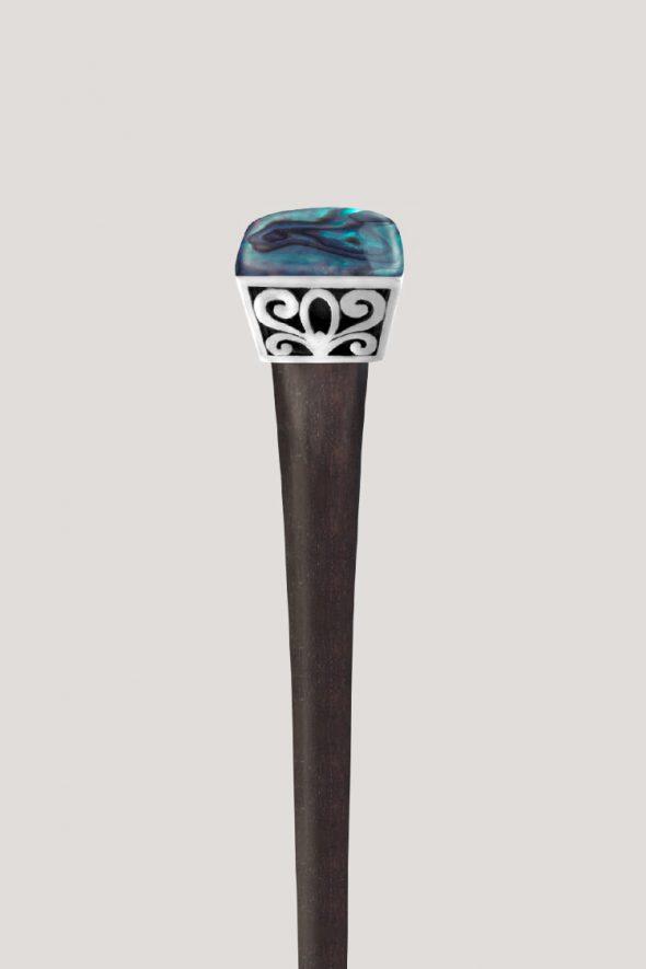 Palo para el cabello concha abalón y acero. ¡Un toque natural y elegante para tus peinados!